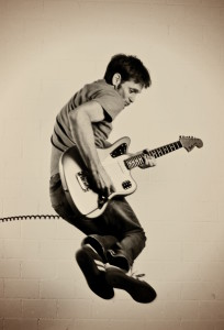 Luki Jumping with guitar